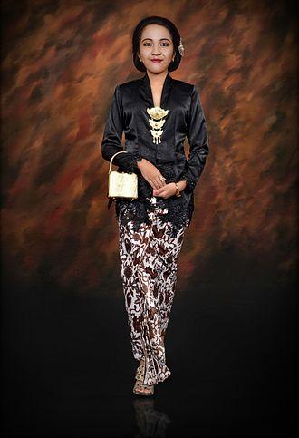 Kebaya - Javanese kebaya black silk secured with kerongsang brooch, and kain batik as skirt