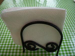 Napkin holder - A typical upright napkin holderù