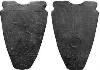 31st century BC - Front and Back Sides of Narmer Palette, this facsimile on display at the Royal Ontario Museum, in Toronto, Ontario, Canada. The Palette depicts Narmer unifying Upper Egypt and Lower Egypt