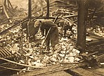 National Army soldiers search remains of a fire during Irish Civil War 1922 (6314582749).jpg