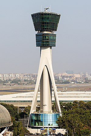 Air traffic control - Chhatrapati Shivaji International Airport control tower in Mumbai, India.