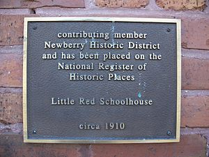 Contributing property - Plaque acknowledging Little Red Schoolhouse as a contributing property to Newberry Historic District in Newberry, Florida