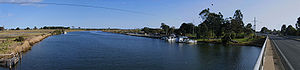 Nicholson, Victoria - Looking south along the Nicholson River, with the boat ramp and Princes Highway to the right