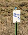 No Hunting Zone Sign with Mountain Bluebird Seedskadee NWR (15894858220).jpg