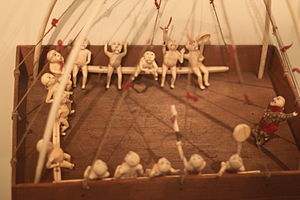 Yup'ik - Wooden qasgiruaq (qasgiq model) with walrus ivory dolls. Ethnological Museum of Berlin.