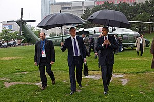 2010 G20 Toronto summit - Barack Obama (right) and David Cameron (centre) arrive after travelling together on Marine One from Huntsville