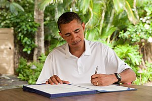 English: President Barack Obama signs H.R. 847...