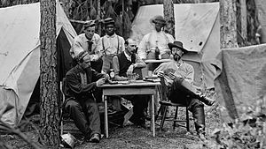 History of poker - Officers of the 114th Pennsylvania Infantry playing cards in front of tents. Petersburg, Virginia, August 1864