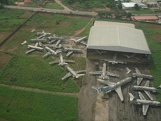 Okada Air - The abandoned fleet of Okada Air at the Benin Airport, 2006. One Boeing 727 and 17 BAC 1-11 are visible