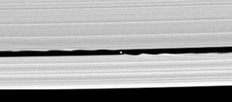 Daphnis (moon) - Daphnis was resolved into a disc for the first time in this 2005 Cassini probe image. The gravitational waves on the edges of the rings, which had earlier hinted at the moon's presence, are clearly visible.