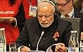 """PM Modi speaking at the 2014 G20 session on """"Delivering Global Economic Resilience"""".jpg"""