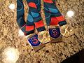 Patrick Meek 25000 & 50000 meter medals (2012).jpg