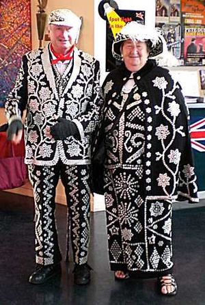 Cockney - A costume associated with cockneys is that of the pearly King or Queen, worn by London costermongers who sew thousands of pearl buttons onto their clothing in elaborate and creative patterns.