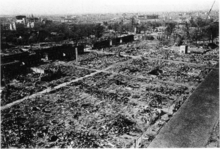 Black and white aerial photograph of a devastated urban area
