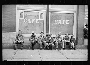 "Pikeville, Tennessee - Carl Mydans photo showing local residents ""spelling"" themselves in front of a Pikeville store in 1936"