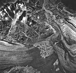 Plateau and Carroll Glaciers, glacial lake with icebergs, outwash and remnents, August 24, 1963 (GLACIERS 5766).jpg