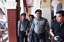Police escort detained Reuters journalist Kyaw Soe Oo.jpg