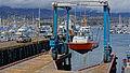 Portable boat lift totes a Santa Barbara patrol boat.jpg