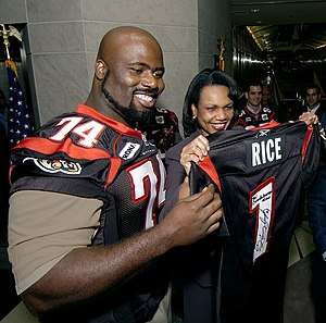 Johnny Scott (Canadian football) - Scott presents an Ottawa Renegades jersey to U.S. Secretary of State Condoleezza Rice at the American Embassy in 2005.