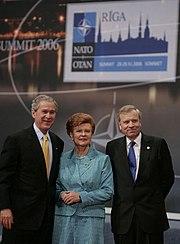 President George W. Bush stands with President Vaira Vike-Freiberga of Latvia, and NATO Secretary General Jaap de Hoop Scheffer