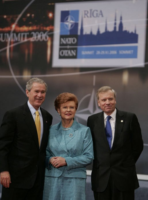 President George W. Bush stands with President Vaira Vike-Freiberga of Latvia, and NATO Secretary General Jaap de Hoop Scheffer