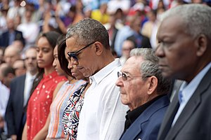 Reactions to the 2016 Brussels bombings - Cuban president Raúl Castro and the visiting Obama family observing a minute of silence at a Baseball game.