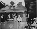 President and Mrs. Harry S. Truman, Margaret Truman, and an unidentified man standing on the rear platform of the... - NARA - 199963.tif