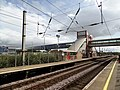 Prestwick International Airport railway station - view towards Ayr with airport link overbridge.jpg