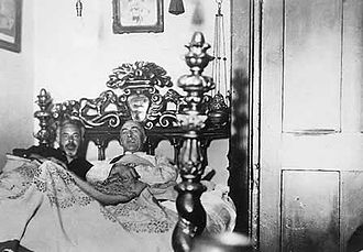 C. E. M. Joad - Joad with the psychic researcher Harry Price in an alleged haunted bed.