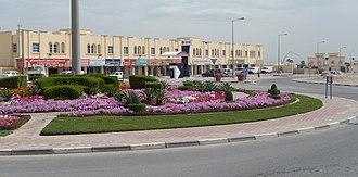 Simaisma - A roundabout with shops.