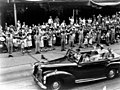 Queen Elizabeth II and the Duke of Edinburgh travel along Queen Street, Brisbane, on the last day of their Queensland tour in 1954 (6798751304).jpg