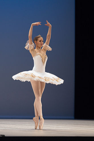 Pointe technique - Body alignment and foot placement are fundamental aspects of pointe technique, as illustrated by this en pointe dancer