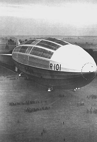 Mooring mast - The R101 being handled on the ground, showing the size of the landing party required to manage a large airship.  One purpose of a mooring mast was to reduce the number of men needed to manage the landing process.