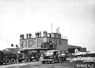 RAF Molesworth - RAF Molesworth Control Tower, taken on 28 September 1944, with wing staff waiting on the return of the 303d Bombardment Group from a mission. Note Lockheed/Vega B-17G-60-VE Fortress 44-8328 359th Bombardment Squadron (Code BN) parked next to tower