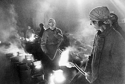 Russian women working in city factory at the height of the Siege of Leningrad RIAN archive 348 During the siege.jpg