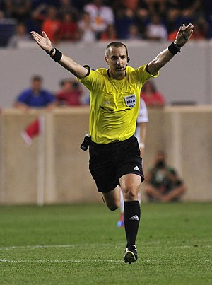 Fouls and misconduct (association football) - Referee Mark Geiger signals for advantage