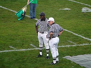 Official (American football) - A pair of officials at a Maryland high school football game in September 2008. White knickers used to be worn by officials; black trousers are now standard.