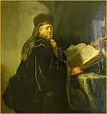 Rembrandt, A Scholar Seated at a Table with Books, 1634, Prague.jpg