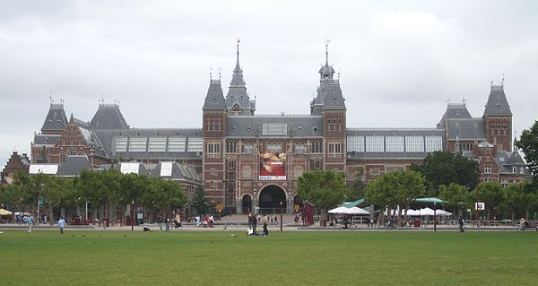"The Rijksmuseum was designed by Cuypers in a combination of both Renaissance and Gothic styles in the late 1870s. The result is similar to the Hotel de Ville in Paris in what is considered to be ""French Neo-Renaissance"" style. However, at the Rijksmuseum the Gothic elements seem to outweigh the Renaissance and the building, despite the English Renaissance quoins, and chateauesque roofs, is sometimes considered to be Neo-Gothic. Rijksmuseum Amsterdam.jpg"