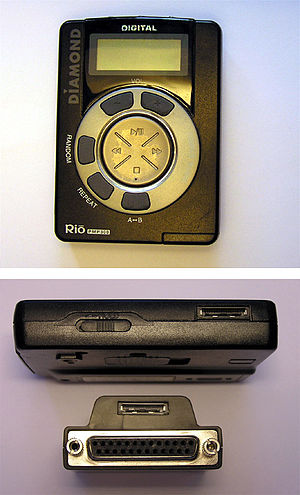 Rio PMP300 - The Rio PMP-300 portable MP3 player. The top view shows the face of the player. The bottom view shows the edge of the player (including its proprietary connector) and the included parallel-port adaptor.