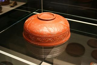 Terra sigillata fine red Ancient Roman pottery with glossy surface slips made in specific areas of the Roman Empire
