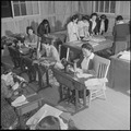 Rohwer Relocation Center, McGehee, Arkansas. A sewing class in the adult education division of the . . . - NARA - 539362.tif