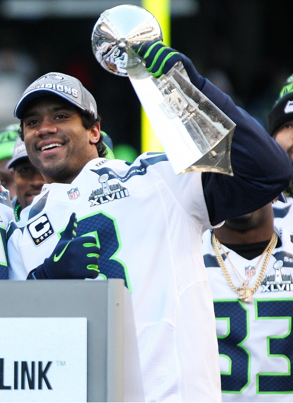 Russell Wilson with Lombardi Trophy