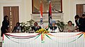 S.M. Krishna and the Minister of Agriculture and Food Security, Malawi, Prof. Peter Mwanza signing the General Cooperation Agreement, between India and Malawi, in the presence of the Prime Minister.jpg