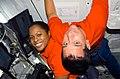S116E07456 - STS-116 - STS-116 Crewmembers Higginbotham and Oefelein working in the U.S. Laboratory - DPLA - 4bbbcc60e8c2f089e8fb84daa9e283bd.jpg