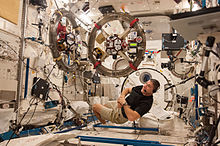 Two SPHERES satellites with the RINGS add-ons are being used in an experiment by NASA astronaut Michael Hopkins.