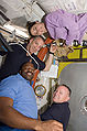 STS-129 Astronauts in the Quest airlock.jpg