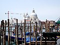 Santa Maria della Salute with construction cranes and gondola mooring posts.jpg
