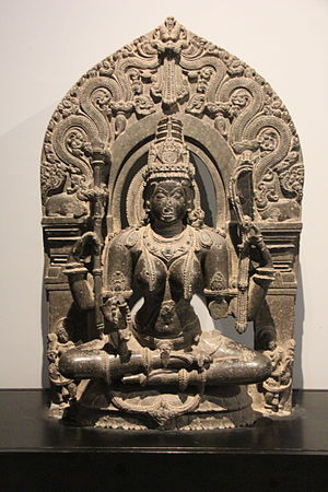 Saraswati - Saraswati idol carved of black stone from Chalukya dynasty (12 century CE). Idol on display in Prince of Wales Museum, Mumbai.