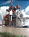 Saturn V First Stage Lifted into Test Stand. - GPN-2000-000559.jpg